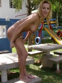 Amateur dickgirl photos - getting naked in the backyard
