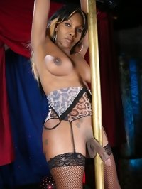 Ebony shemale whore dances a striptease in sex club