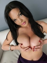 Brunette dickgirl Jonelle Brooks shows off big hormonal tits